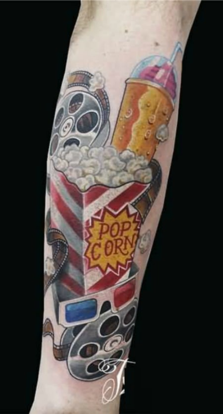 Movie cinema themed tattoo.