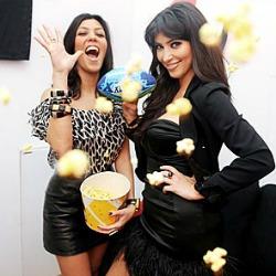 Kim and Kourtney Kardashian Tossing Popcorn at the Pepsi Max Lounge
